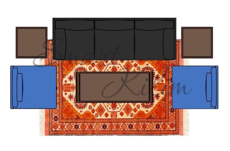 Передние ножки дивана и кресел расположены на ковре в гостиной